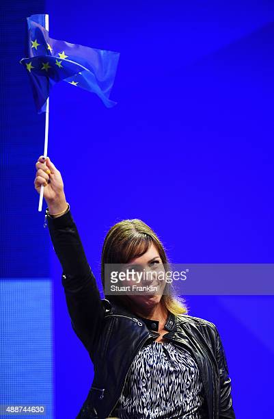 Karine Icher of team Europe waves at the opening ceremony prior to the start of the Solheim Cup at St LeonRot Golf Club on September 17 2015 in St...