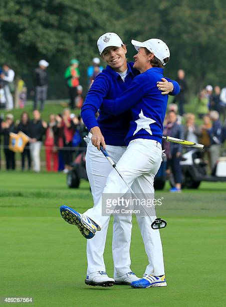 Karine Icher of the European team is congratulated by her partner Catriona Matthew after Icher had holed a bridie putt on the 17th green to win their...