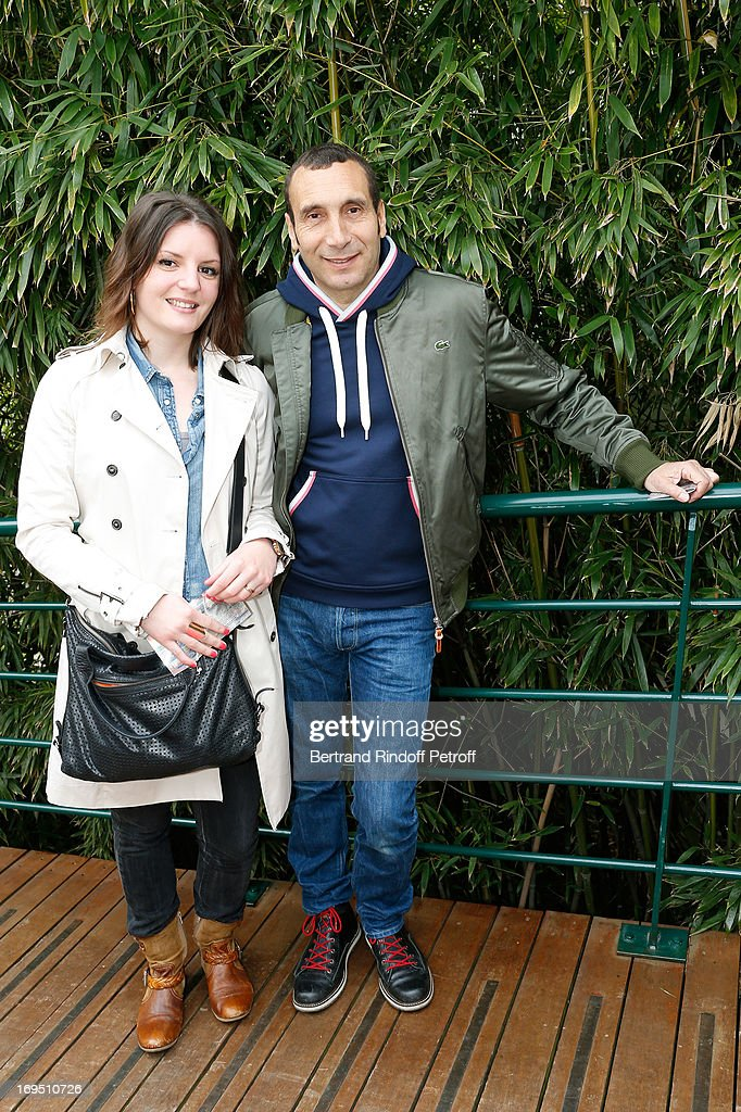 Karine Santin and <a gi-track='captionPersonalityLinkClicked' href=/galleries/search?phrase=Zinedine+Soualem&family=editorial&specificpeople=628313 ng-click='$event.stopPropagation()'>Zinedine Soualem</a> attend Roland Garros Tennis French Open 2013 - Day 1 on May 26, 2013 in Paris, France.
