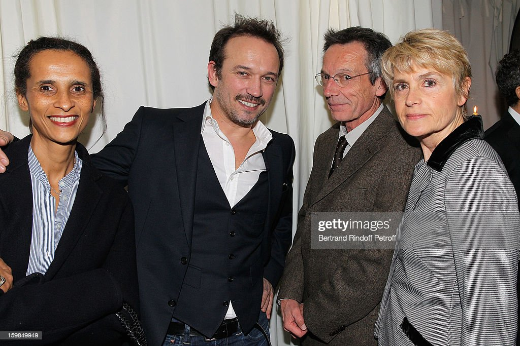 Karine Silla, her husband Vincent Perez, Patrice Leconte and his wife attend 'La Petite Maison De Nicole' Inauguration Cocktail at Hotel Fouquet's Barriere on January 21, 2013 in Paris, France.