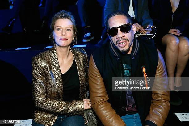 Karine Viard and JoeyStarr attend ETAM show as part of the Paris Fashion Week Womenswear Fall/Winter 20142015 on February 25 2014 in Paris France