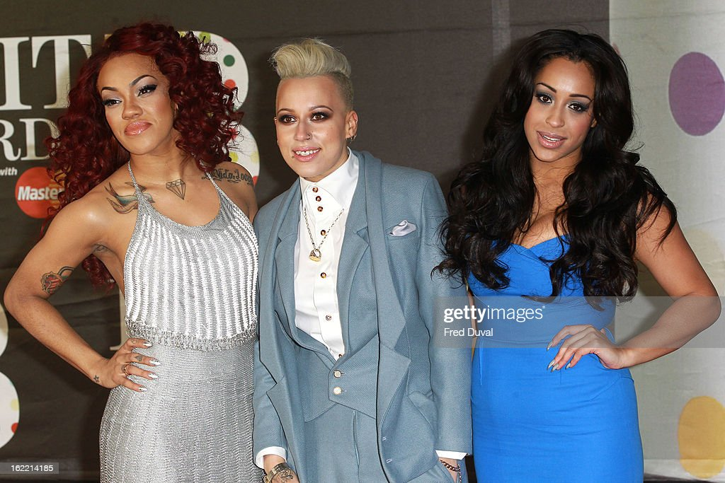 Karis Anderson, Courtney Rumbold and Alex Buggs of Stooshe attend the Brit Awards at 02 Arena on February 20, 2013 in London, England.
