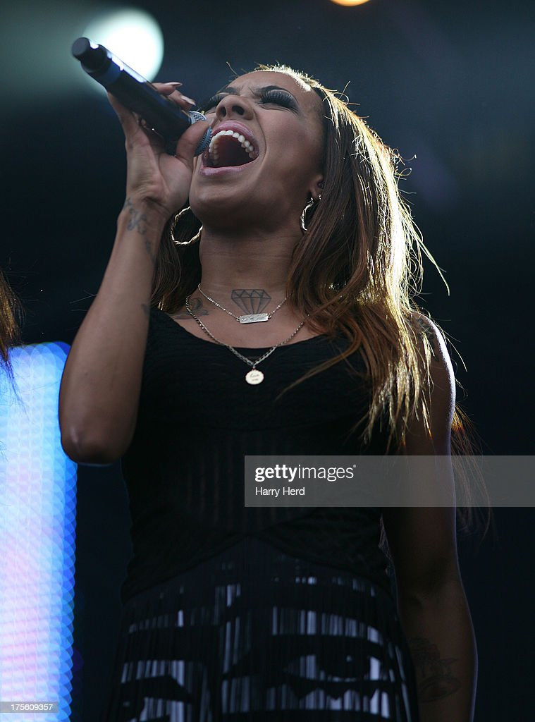 <a gi-track='captionPersonalityLinkClicked' href=/galleries/search?phrase=Karis+Anderson&family=editorial&specificpeople=8828468 ng-click='$event.stopPropagation()'>Karis Anderson</a> of Stooshe performs on stage at Lytham Proms at Royal Lytham & St. Annes on August 4, 2013 in Lytham St Annes, England.