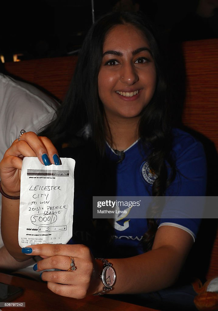 Karishma Kapoor a Leicester City supporter shows off her betting slip as Leicester City fans gather in the Local Hero pub to watch their match against Manchester United on May 1, 2016, 2016 in Leicester, England.