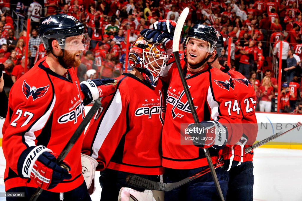 <a gi-track='captionPersonalityLinkClicked' href=/galleries/search?phrase=Karl+Alzner&family=editorial&specificpeople=3938829 ng-click='$event.stopPropagation()'>Karl Alzner</a> #27, <a gi-track='captionPersonalityLinkClicked' href=/galleries/search?phrase=Braden+Holtby&family=editorial&specificpeople=5370964 ng-click='$event.stopPropagation()'>Braden Holtby</a> #70 and John Carlson #74 of the Washington Capitals celebrate a win after Game Four of the Eastern Conference Semifinals of the 2012 NHL Stanley Cup Playoffs against the New York Rangers on May 5, 2012 at the Verizon Center in Washington, DC.