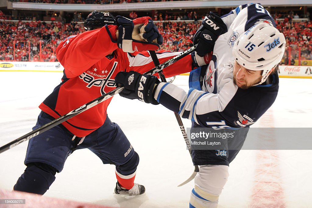 <a gi-track='captionPersonalityLinkClicked' href=/galleries/search?phrase=Karl+Alzner&family=editorial&specificpeople=3938829 ng-click='$event.stopPropagation()'>Karl Alzner</a> #27 of the Washington Capitals and <a gi-track='captionPersonalityLinkClicked' href=/galleries/search?phrase=Tanner+Glass&family=editorial&specificpeople=4596666 ng-click='$event.stopPropagation()'>Tanner Glass</a> #15 of the Winnipeg Jets push each other away during a NHL hockey game on November 23, 2011 at the Verizon Center in Washington, DC.