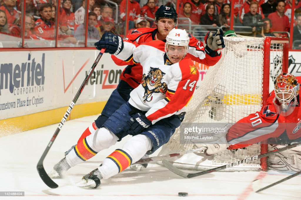 <a gi-track='captionPersonalityLinkClicked' href=/galleries/search?phrase=Karl+Alzner&family=editorial&specificpeople=3938829 ng-click='$event.stopPropagation()'>Karl Alzner</a> #27 of the Washington Capitals and <a gi-track='captionPersonalityLinkClicked' href=/galleries/search?phrase=Tomas+Fleischmann&family=editorial&specificpeople=554398 ng-click='$event.stopPropagation()'>Tomas Fleischmann</a> #14 of the Florida Panthers fight for the puck during a NHL hockey game on April 5, 2012 at the Verizon Center in Washington, DC.