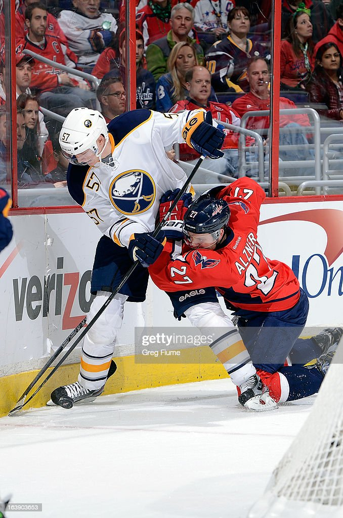 <a gi-track='captionPersonalityLinkClicked' href=/galleries/search?phrase=Karl+Alzner&family=editorial&specificpeople=3938829 ng-click='$event.stopPropagation()'>Karl Alzner</a> #27 of the Washington Capitals battles for the puck against <a gi-track='captionPersonalityLinkClicked' href=/galleries/search?phrase=Tyler+Myers&family=editorial&specificpeople=4595080 ng-click='$event.stopPropagation()'>Tyler Myers</a> #57 of the Buffalo Sabres at the Verizon Center on March 17, 2013 in Washington, DC.