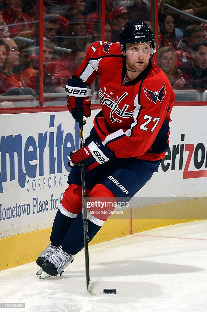 <a gi-track='captionPersonalityLinkClicked' href=/galleries/search?phrase=Karl+Alzner&family=editorial&specificpeople=3938829 ng-click='$event.stopPropagation()'>Karl Alzner</a> #27 of the Washington Capitals brings puck around behind the net during the third period of an NHL hockey game against the Buffalo Sabres at Verizon Center on January 27, 2013 in Washington, DC.