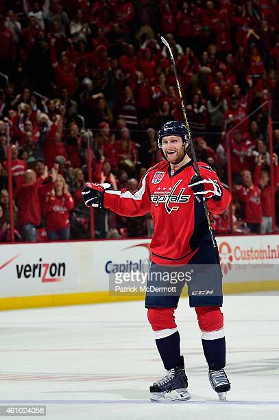 Karl Alzner of the Washington Capitals celebrates after scoring a goal in the second period against the Florida Panthers during an NHL game at...