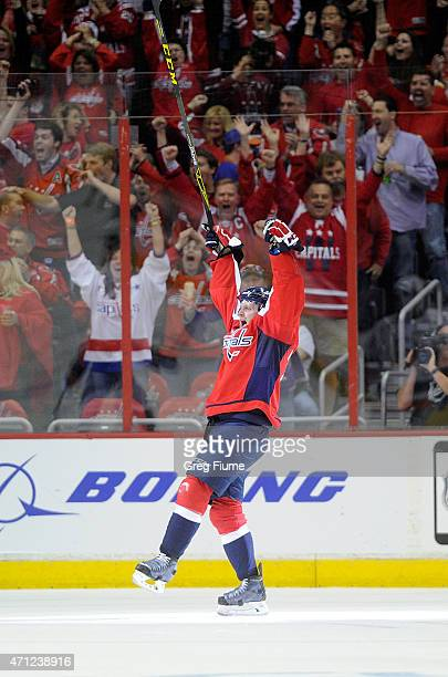 Karl Alzner of the Washington Capitals celebrates after scoring in the second period against the New York Islanders during Game Two of the Eastern...