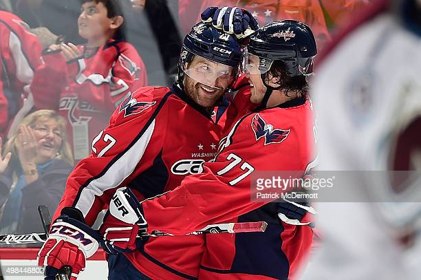 Karl Alzner of the Washington Capitals celebrates with his teammate TJ Oshie after scoring a goal against the Colorado Avalanche in the third period...