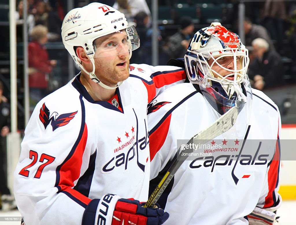 <a gi-track='captionPersonalityLinkClicked' href=/galleries/search?phrase=Karl+Alzner&family=editorial&specificpeople=3938829 ng-click='$event.stopPropagation()'>Karl Alzner</a> #27 of the Washington Capitals congratulates goaltender <a gi-track='captionPersonalityLinkClicked' href=/galleries/search?phrase=Braden+Holtby&family=editorial&specificpeople=5370964 ng-click='$event.stopPropagation()'>Braden Holtby</a> #70 following a 3-0 shutout against the Winnipeg Jets at the MTS Centre on March 2, 2013 in Winnipeg, Manitoba, Canada.