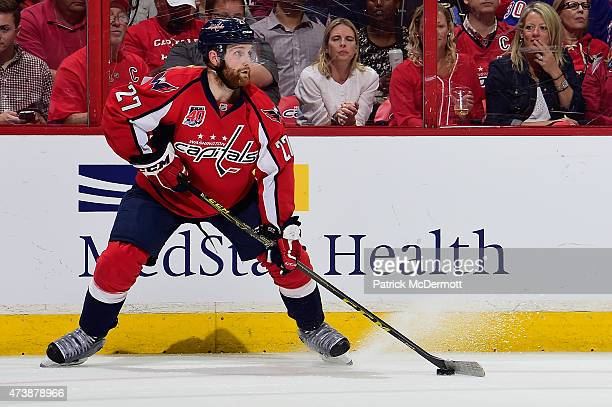 Karl Alzner of the Washington Capitals controls the puck against the New York Rangers during the first period in Game Four of the Eastern Conference...