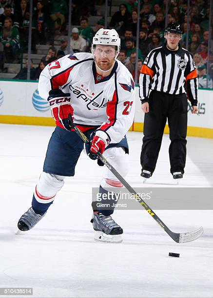 Karl Alzner of the Washington Capitals handles the puck against the Dallas Stars at the American Airlines Center on February 13 2016 in Dallas Texas
