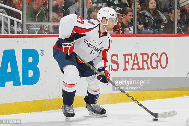 Karl Alzner of the Washington Capitals handles the puck against the Minnesota Wild during the game on February 11 2016 at the Xcel Energy Center in...