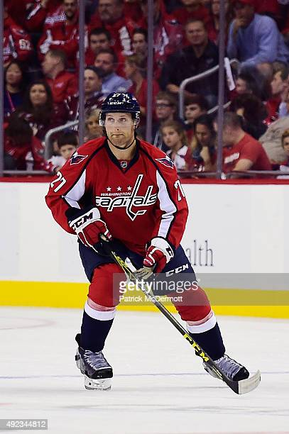Karl Alzner of the Washington Capitals moves the puck up ice against the New Jersey Devils in the first period during the Capitals NHL season opener...
