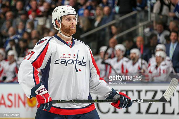 Karl Alzner of the Washington Capitals sets for a faceoff against the Toronto Maple Leafs during the first period at the Air Canada Centre on...