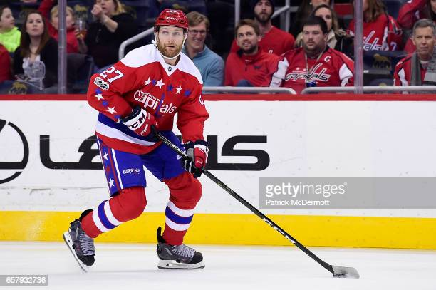 Karl Alzner of the Washington Capitals skates with the puck against the Columbus Blue Jackets in the first period during an NHL game at Verizon...