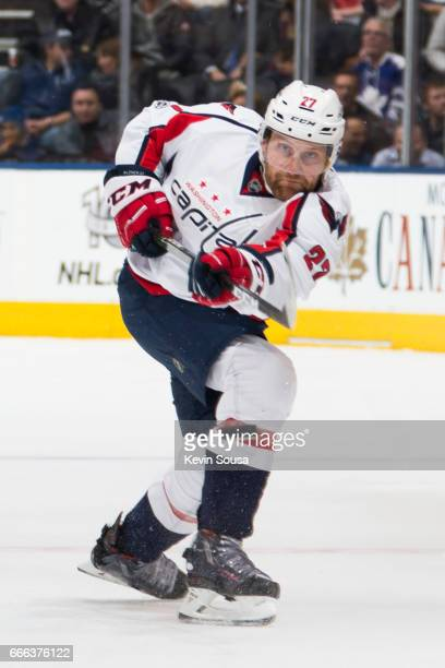 Karl Alzner of the Washington Capitals takes a shot against the Toronto Maple Leafs during the first period at the Air Canada Centre on April 4 2017...