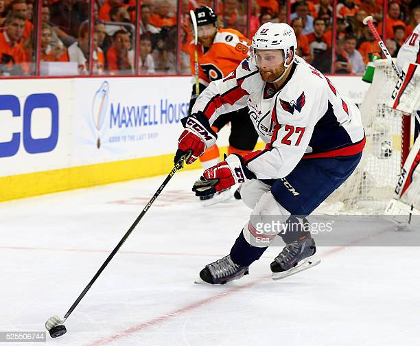Karl Alzner of the Washington Capitals takes the puck as Jakub Voracek of the Philadelphia Flyers defends in Game Three of the Eastern Conference...