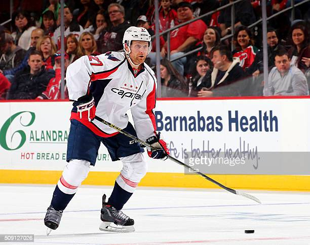 Karl Alzner of the Washington Capitals takes the puck in the first period against the New Jersey Devils on February 6 2016 at Prudential Center in...