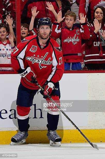 Karl Alzner of the Washington Capitals warms up before playing against the New York Islanders in Game Two of the Eastern Conference Quarterfinals...