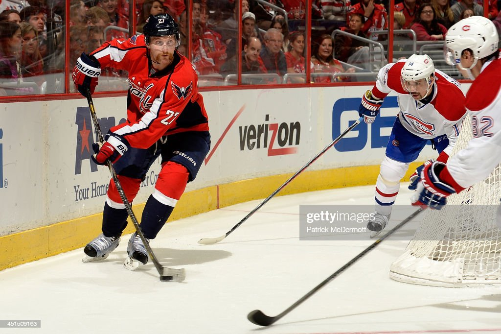 <a gi-track='captionPersonalityLinkClicked' href=/galleries/search?phrase=Karl+Alzner&family=editorial&specificpeople=3938829 ng-click='$event.stopPropagation()'>Karl Alzner</a> #27 of the Washington Capitals works behind the net during the third period of an NHL game against the Montreal Canadiens at Verizon Center on November 22, 2013 in Washington, DC.