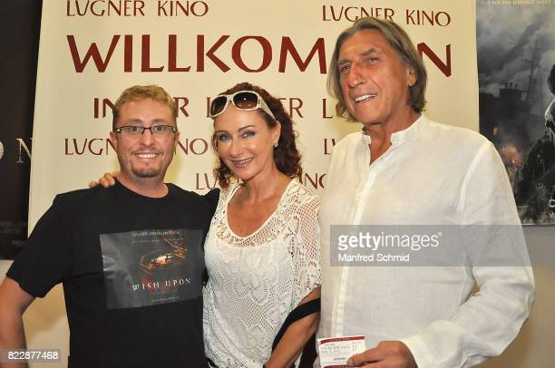 Karl Boetel Christina Lugner and Norbert Blecha pose during the 'Wish Upon' premiere in Vienna at Lugner Lounge Kino on July 25 2017 in Vienna Austria