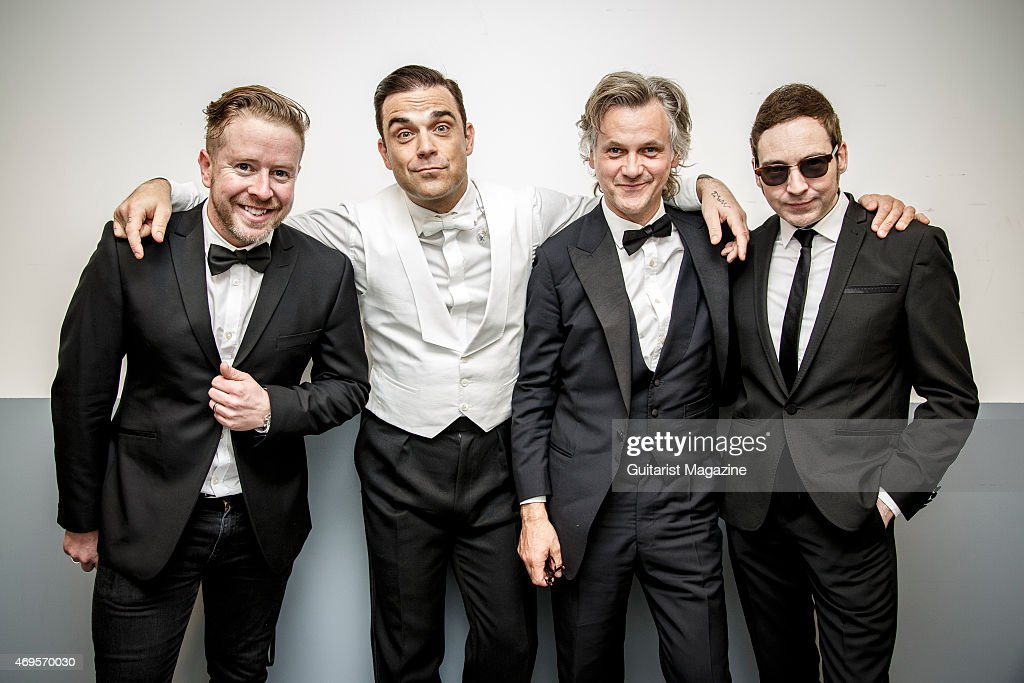Karl Brazil Robbie Williams Guy Chambers and Gary Nuttall photographed before a live performance at the Ziggo Dome in Amsterdam on May 5 2014