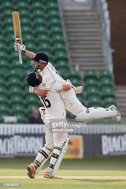 Karl Brown is lifted off his feet by Steven Croft as Lancashire complete victory and win the Championship during the LV County Championship match...