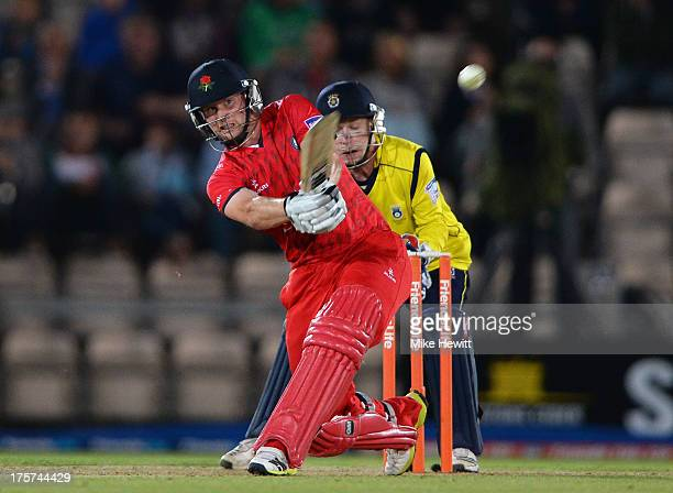 Karl Brown of Lancashire smashes the ball to the boundary for four during the Friends Life T20 Quarter Final between Hampshire Royals and Lancashire...
