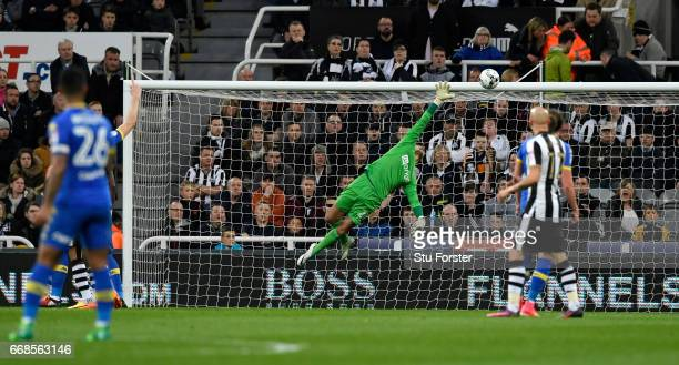 Karl Darlow dives as a shot hits the bar during the Sky Bet Championship match between Newcastle United and Leeds United at St James' Park on April...