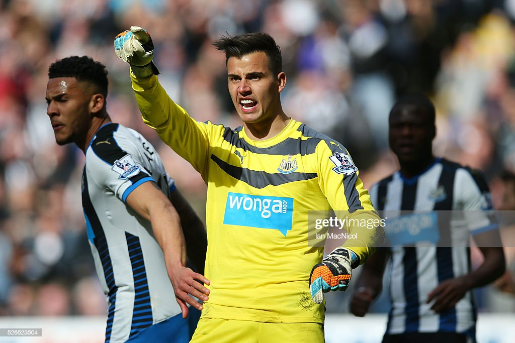 Karl Darlow of Newcastle United is congratulated by Jamaal Lascelles of Newcastle United after saving a penalty during the Barclays Premier League match between Newcastle United and Crystal Palace at St James' Park on April 30, 2016 in Newcastle upon Tyne, England.
