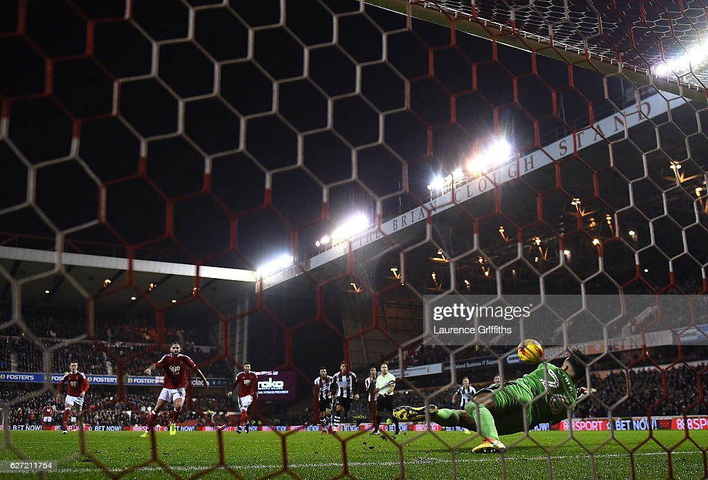 Karl Darlow of Newcastle United saves a penalty from Henri Lansbury of Nottingham Forest during the Sky Bet Championship match between Nottingham Forest and Newcastle United at City Ground on December 2, 2016 in Nottingham, England.