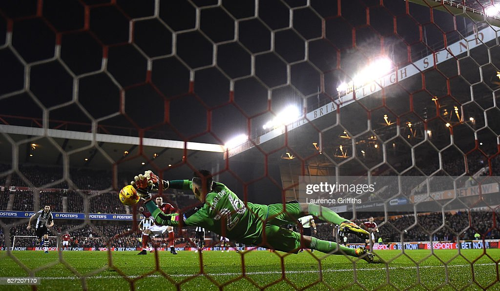Karl Darlow of Newcastle Unitedd saves a penalty from Nicklas Bendtner of Nottingham Forest during the Sky Bet Championship match between Nottingham Forest and Newcastle United at City Ground on December 2, 2016 in Nottingham, England.