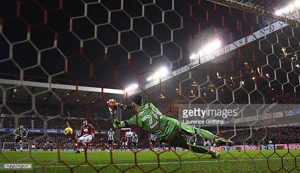 Karl Darlow of Newcastle Unitedd saves a penalty from Nicklas Bendtner of Nottingham Forest during the Sky Bet Championship match between Nottingham...