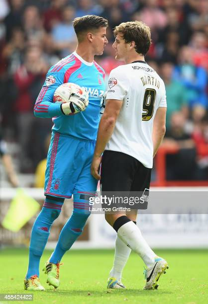 Karl Darlow of Nottingham Forest squares up to Chris Martin of Derby County during the Sky Bet Championship match between Nottingham Forest and Derby...