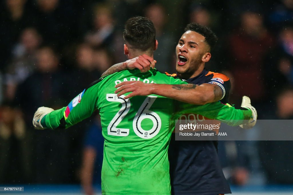 Karl Darrow of Newcastle United and Jamaal Lascelles of Newcastle United celebrate after Dwight Gayle of Newcastle United scores a goal to make to 1-3 during the Sky Bet Championship match between Huddersfield Town and Newcastle United at John Smith's Stadium on March 4, 2017 in Huddersfield, England.
