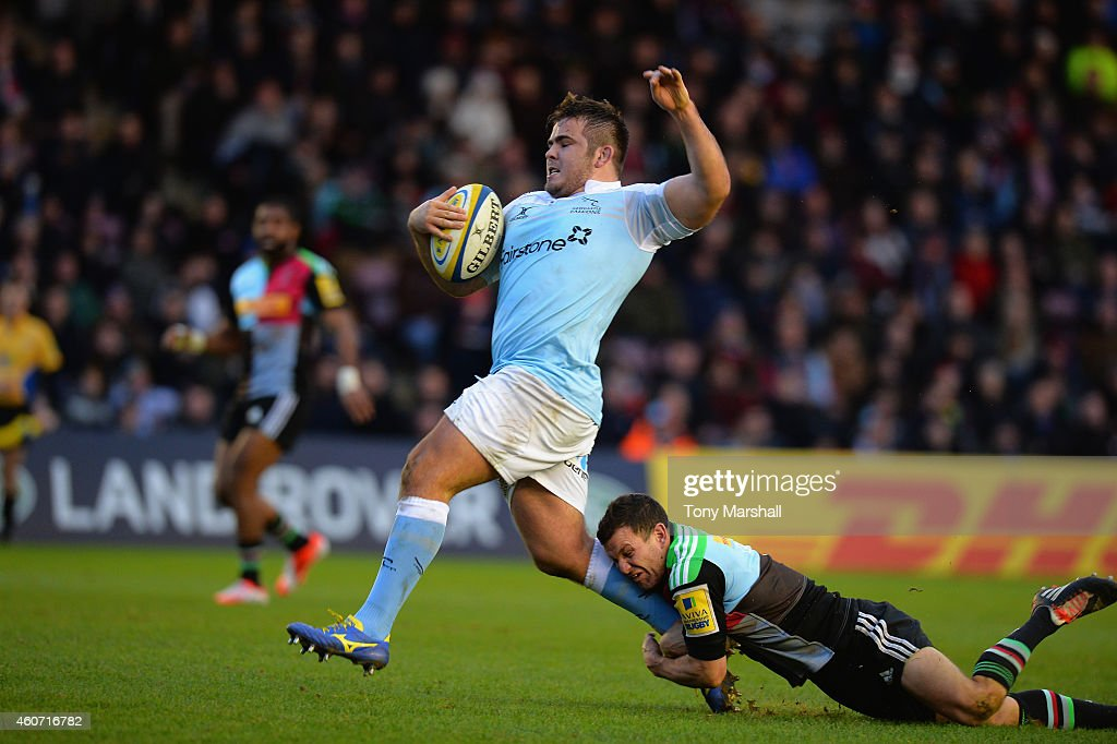 Karl Dickson of Harlequins tackles George McGuigan of Newcastle Falcons during the Aviva Premiership match between Harlequins and Newcastle Falcons at the Twickenham Stoop on December 20, 2014 in London, England.
