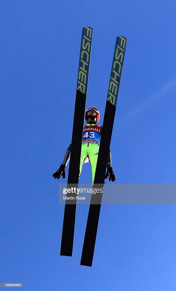 Karl Geiger of Germany competes during the trial round for the FIS Ski Jumping World Cup event of the 61st Four Hills ski jumping tournament at Olympiaschanze on December 31, 2012 in Garmisch-Partenkirchen, Germany.