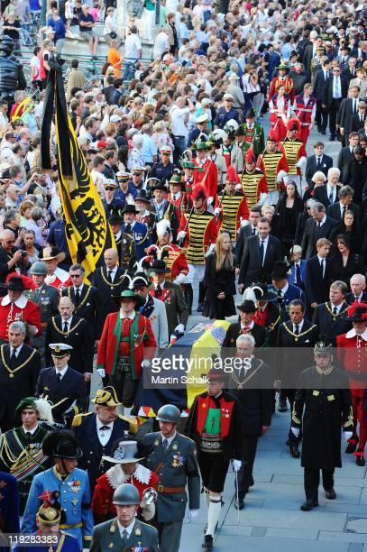 Karl HabsburgLothringen Archduchess Eleonore Archduchess Gloria Francesca von HabsburgLothringen and Georg HabsburgLothringen walk behind the coffin...
