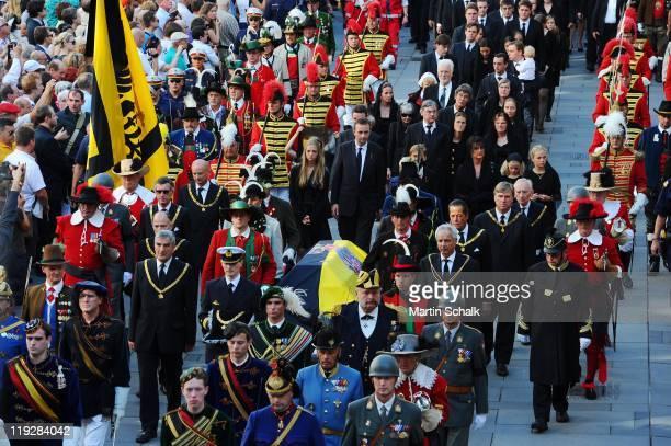 Karl HabsburgLothringen Archduchess Eleonore Archduchess Gloria Francesca von HabsburgLothringen and Georg HabsburgLothringen walk in the cortege...