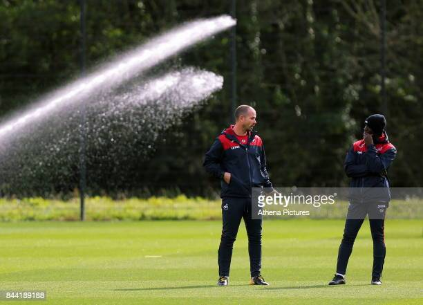 Karl Halabi Swansea Fitness coach and Claude Makelele Swansea assistant coach watch as the players warm up during the Swansea City Training at The...