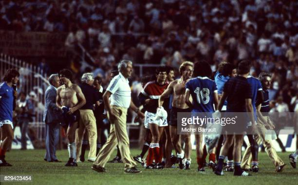 Karl Heinz Rummenigge of Germany and Michel Platini of France at the end of the game Semi Final World Cup match between West Germany and France 8th...