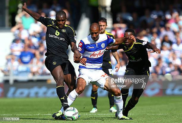 Karl Henry of Queens Park Rangers battles with Jacques Maghoma and Michael Antonio of Sheffield Wednesday during the Sky Bet Championship match...