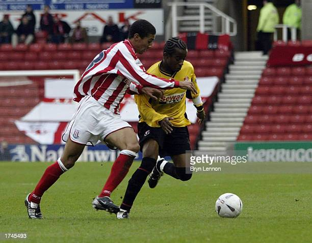 Karl Henry of Stoke City is tackled by Danny Thomas of Bournemouth during the FA Cup Fourth Round game between Stoke City and AFC Bournemouth at...