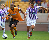 Karl Henry of Wolves tangles with Haris Medunjanin of Real Valladolid during the pre season friendly between Wolverhampton Wanderers and Real...