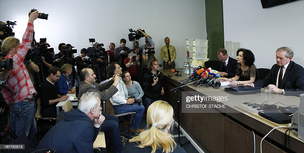Karl Huber, President of the Higher Regional Court Munich (R) (Oberlandesgerichtes Muenchen) and Andrea Titz (C), deputy press speaker of the Higher Regional Court Munich address a press conference on April 29, 2013 in Munich after the lottery for the reserved press seats for the trial against the sole survivor of the far-right militants NSU and four other alleged neo-Nazi accomplices, to take place on May 6, 2013.