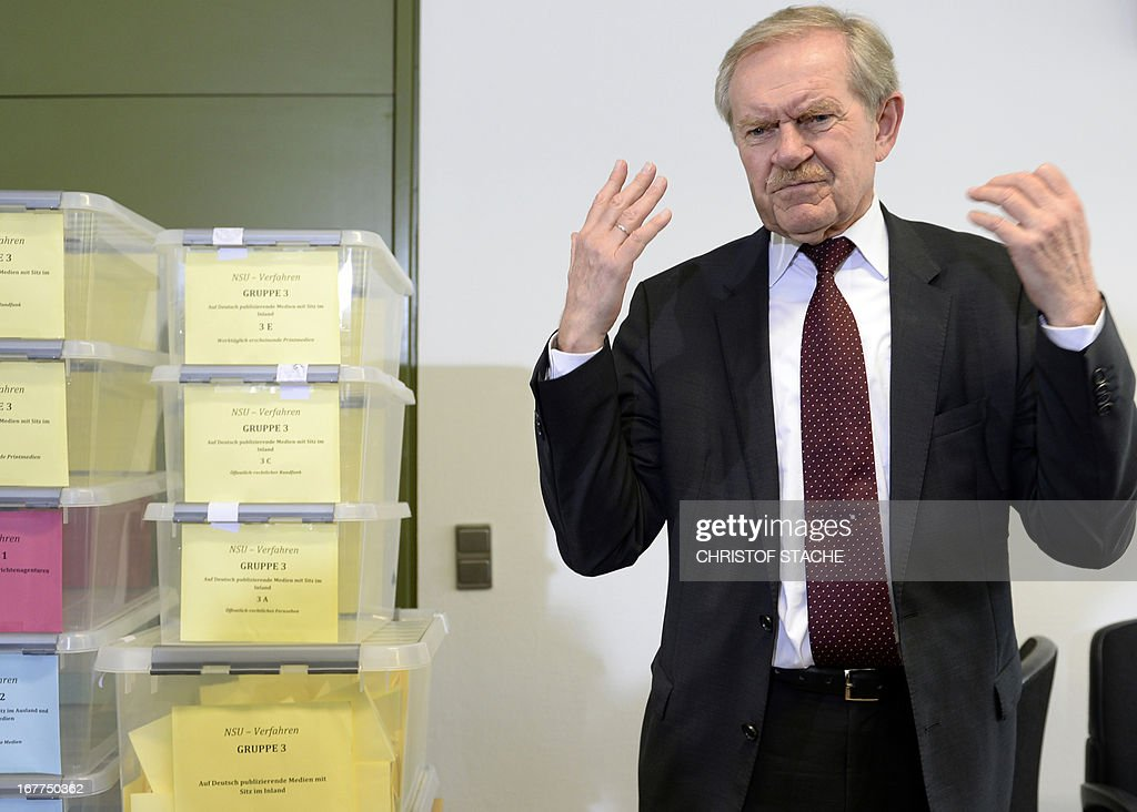 Karl Huber, President of the Higher Regional Court Munich (Oberlandesgerichtes Muenchen), gestures during a press conference on April 29, 2013 in Munich, southern Germany, following the lottery for the reserved press seats for the trial against the sole survivor of the far-right militants NSU and four other alleged neo-Nazi accomplices, to take place on May 6, 2013.